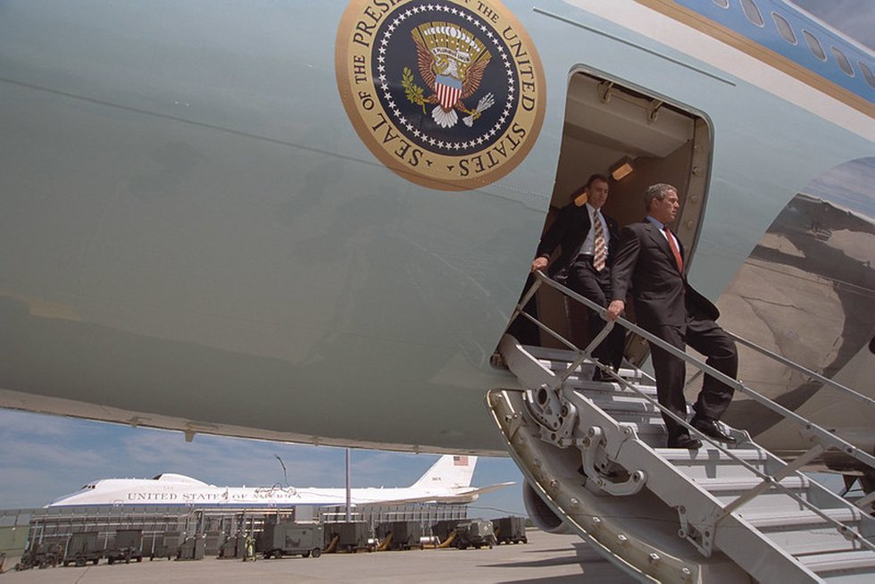 In this file photo from the U.S. National Archives, President Bush deplanes Air Force One at...