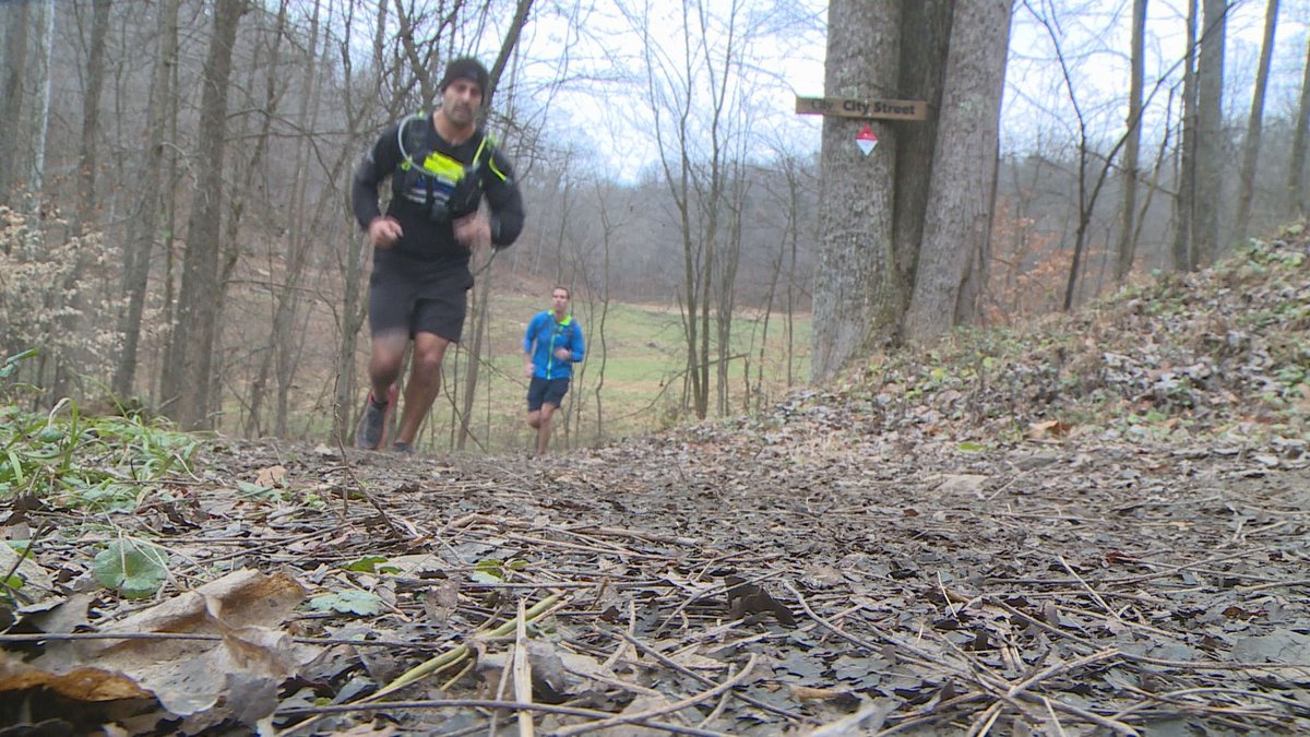 Matt Stevens runs trails in Hurricane for a 24 hour period in order to raise money for Officer...