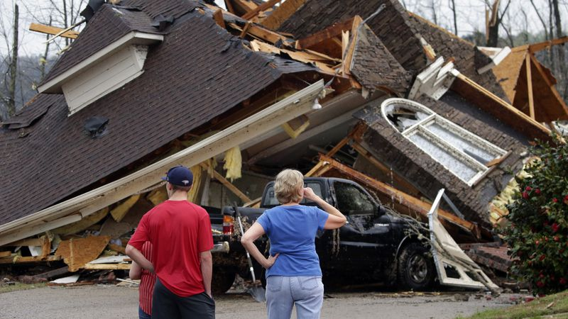 Residents survey damage to homes after a tornado touched down south of Birmingham, Ala. in the...