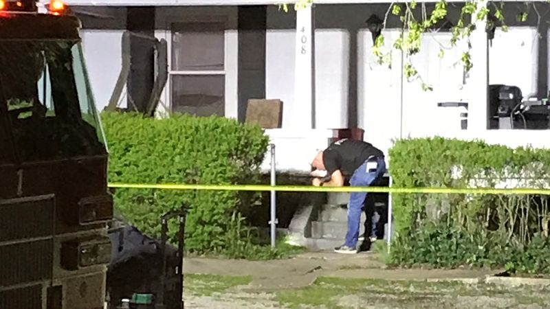 Officers investigate the scene of a shooting on Fourth Street in Grayson on Tuesday night.