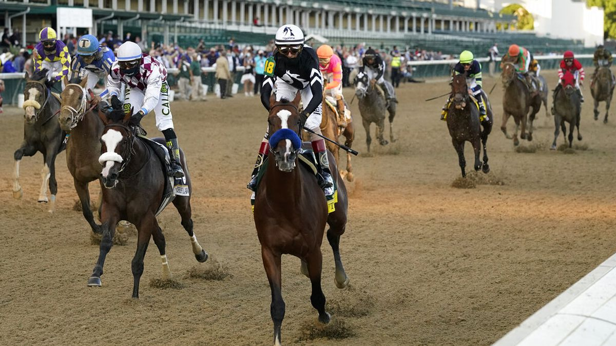 Jockey John Velazquez riding Authentic (18) crosses the finish line to win the 146th running of...