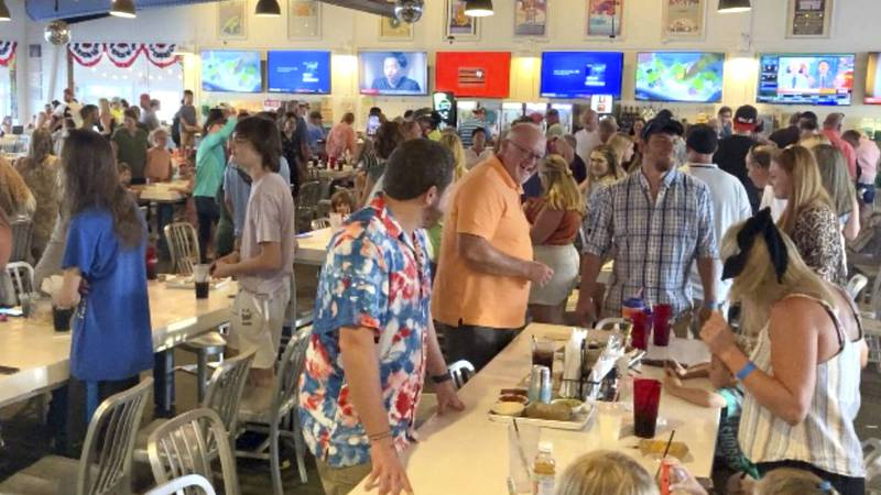 Customers dance inside The Hangout, a popular restaurant in Gulf Shores, Ala., on Thursday,...