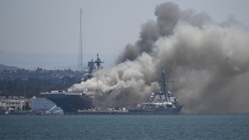 Smoke rises from the USS Bonhomme Richard at Naval Base San Diego Sunday, July 12, 2020, in San...