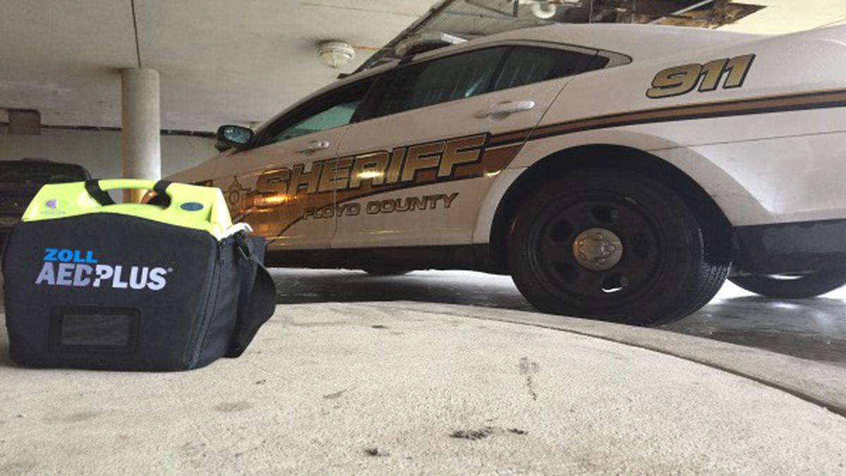 Lifeguard Ambulance Services gave 12 AEDs to make sure all Floyd County Sheriff's Department cruisers equipped.