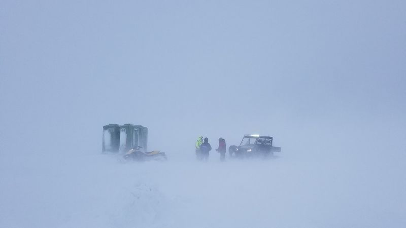 Rescuers on snowmobiles save a guide and 29 ice fishermen trapped in whiteout conditions on the...