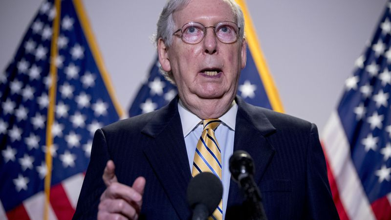 Senate Majority Leader Mitch McConnell, R-Ky., speaks to reporters during a news conference...