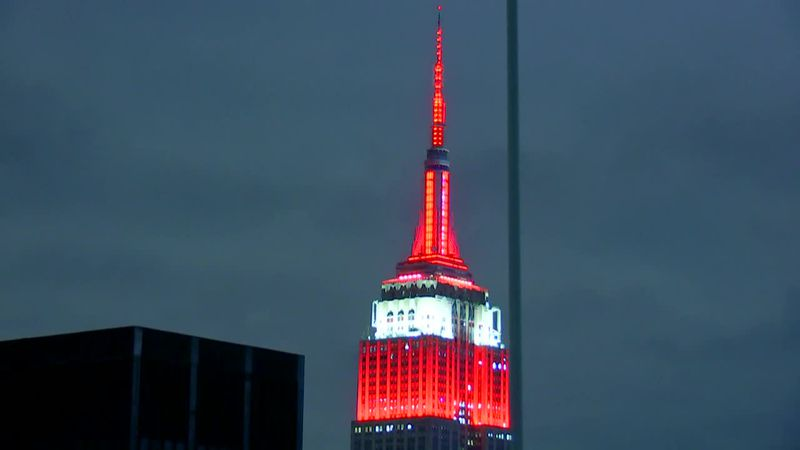 The Empire State Building in New York City is lit up red for the Heisman Trophy winner.