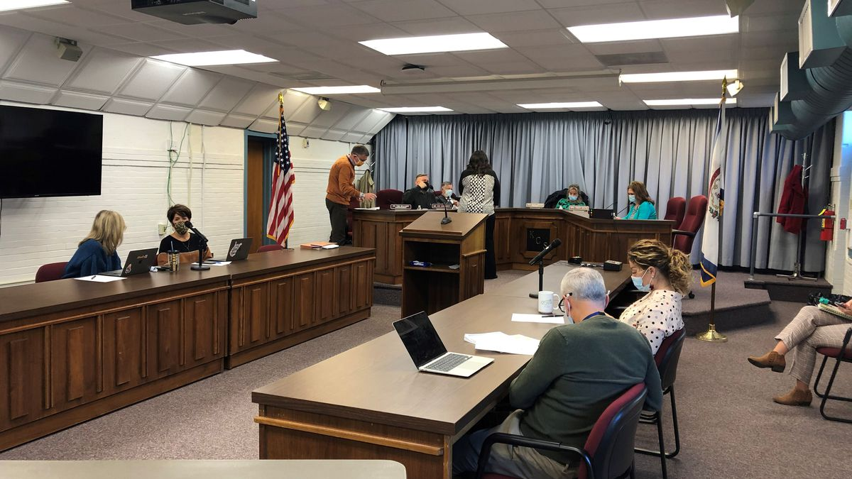 Board member Tracey White issued a motion that the board would say with remote learning pending...