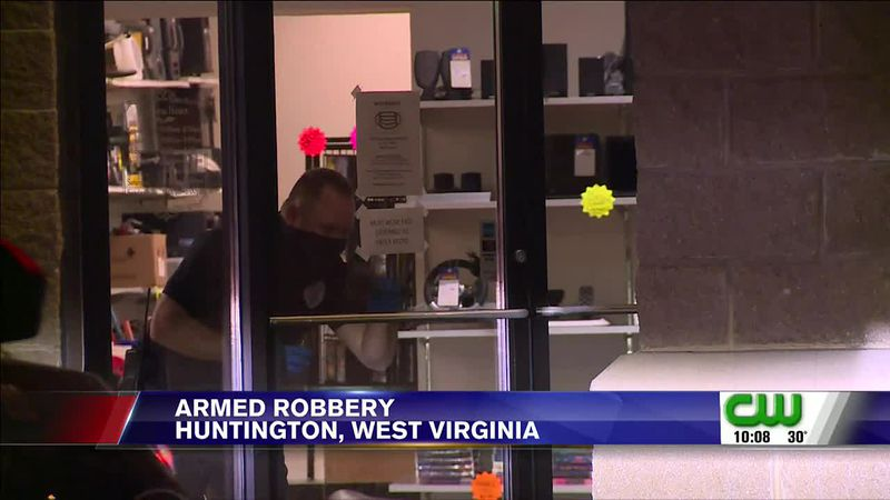 Huntington Police are investigating an armed robbery that happened Friday night at a pawn shop...