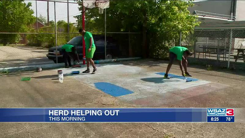 Herd football takes part in beautifying two local community centers