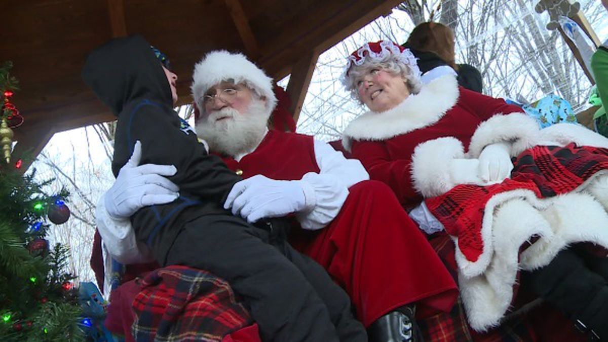 A little boy sits on Santa's lap at the Summersville Lake Retreat and Lighthouse to express his Christmas wishes.