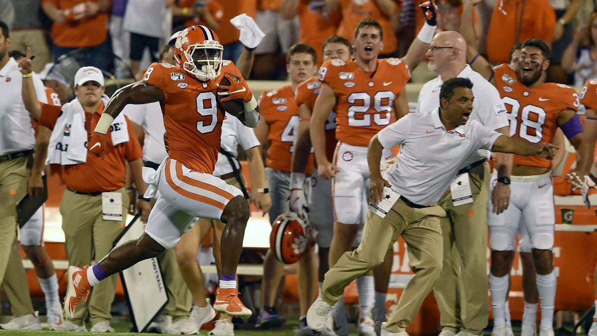 FILE - In this Aug. 29, 2019 file photo, Clemson's Travis Etienne runs down the sideline for a 90-yard touchdown during the first half of an NCAA college football game against Georgia Tech, in Clemson, S.C. Clemson is preseason No. 1 in The Associated Press Top 25, Monday, Aug. 24, 2020, a poll featuring nine Big Ten and Pac-12 teams that gives a glimpse at what's already been taken from an uncertain college football fall by the pandemic.