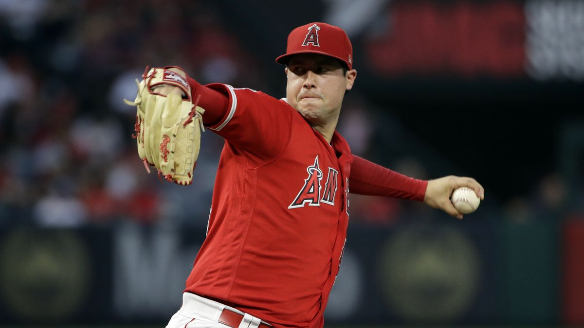 In this June 29, 2019, file photo, Los Angeles Angels starting pitcher Tyler Skaggs throws to...