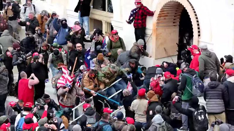 Other segments of the video show rioters throwing items at officers trying to maintain a...