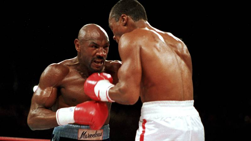 """FILE - In this April 1987 file photo, """"Marvelous"""" Marvin Hagler, left, moves in on """"Sugar"""" Ray..."""
