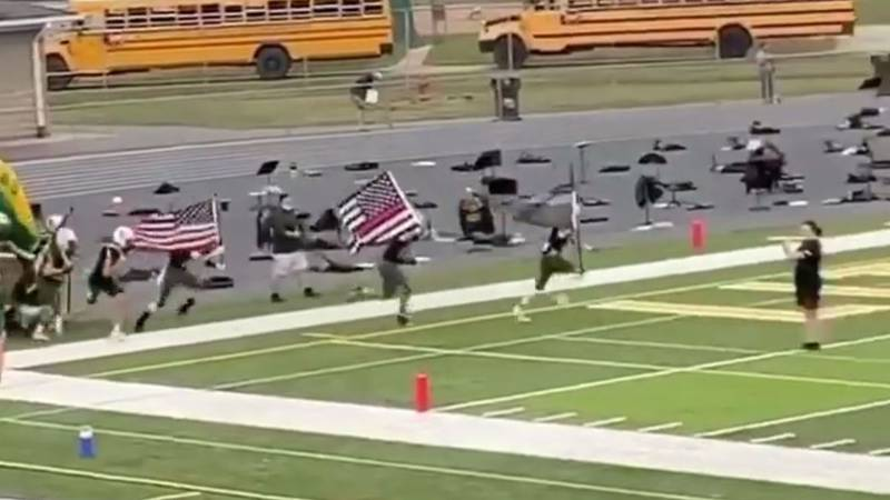 Ohio football players suspended after carrying thin blue line, thin red line flags onto field