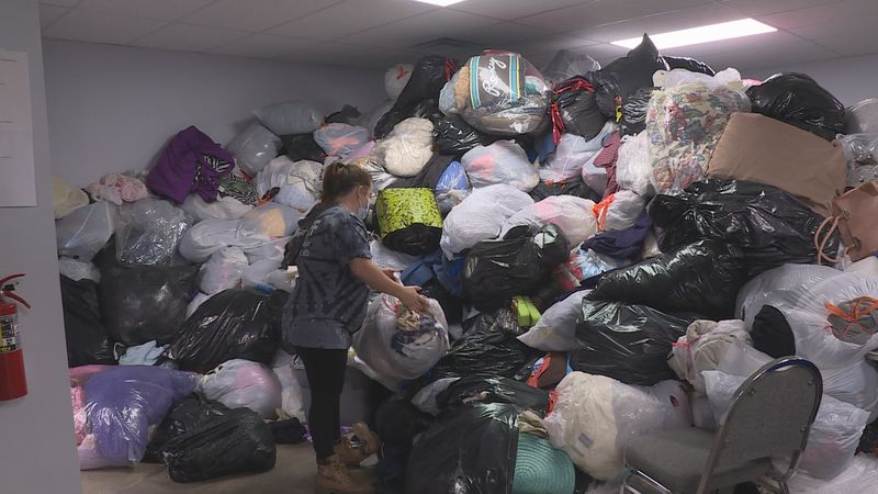 Because of this mountain of clothes and a lack of volunteers, Heart and Hand thrift store in...