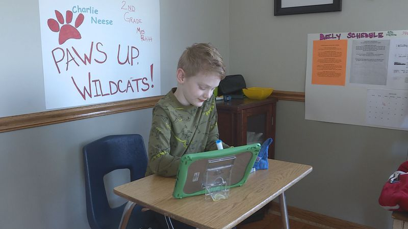 Second-grader Charlie Neese completes a remote learning assignment.