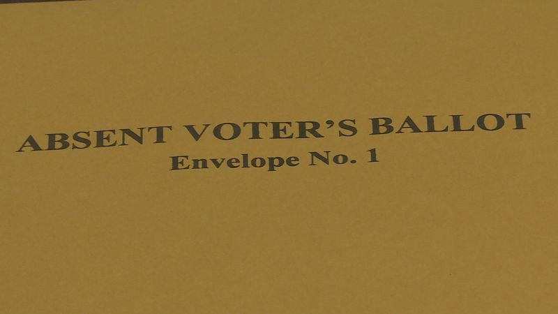 Secrecy envelope that absentee ballots must be put inside to separate them from a voter's...