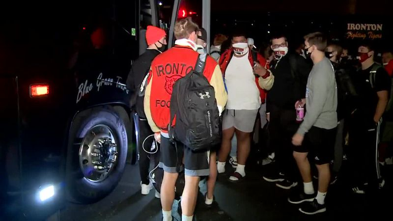 A large crowd gathered outside Ironton High School Friday night as the team boarded buses.