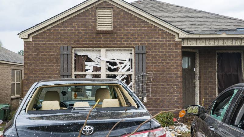 Homes and cars on Waterbury Drive were heavily damaged from severe weather, Wednesday, March...