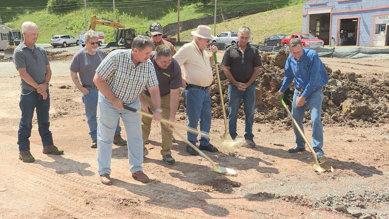 Burnsville community leaders use golden shovels to break the ground on the town's new Dollar...