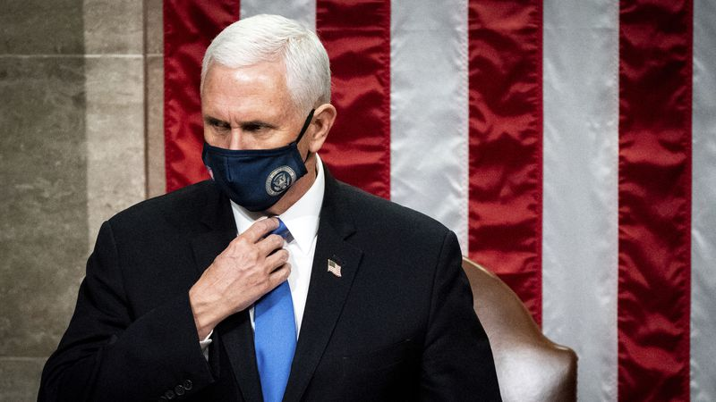 Vice President Mike Pence officiates as a joint session of the House and Senate reconvenes to...