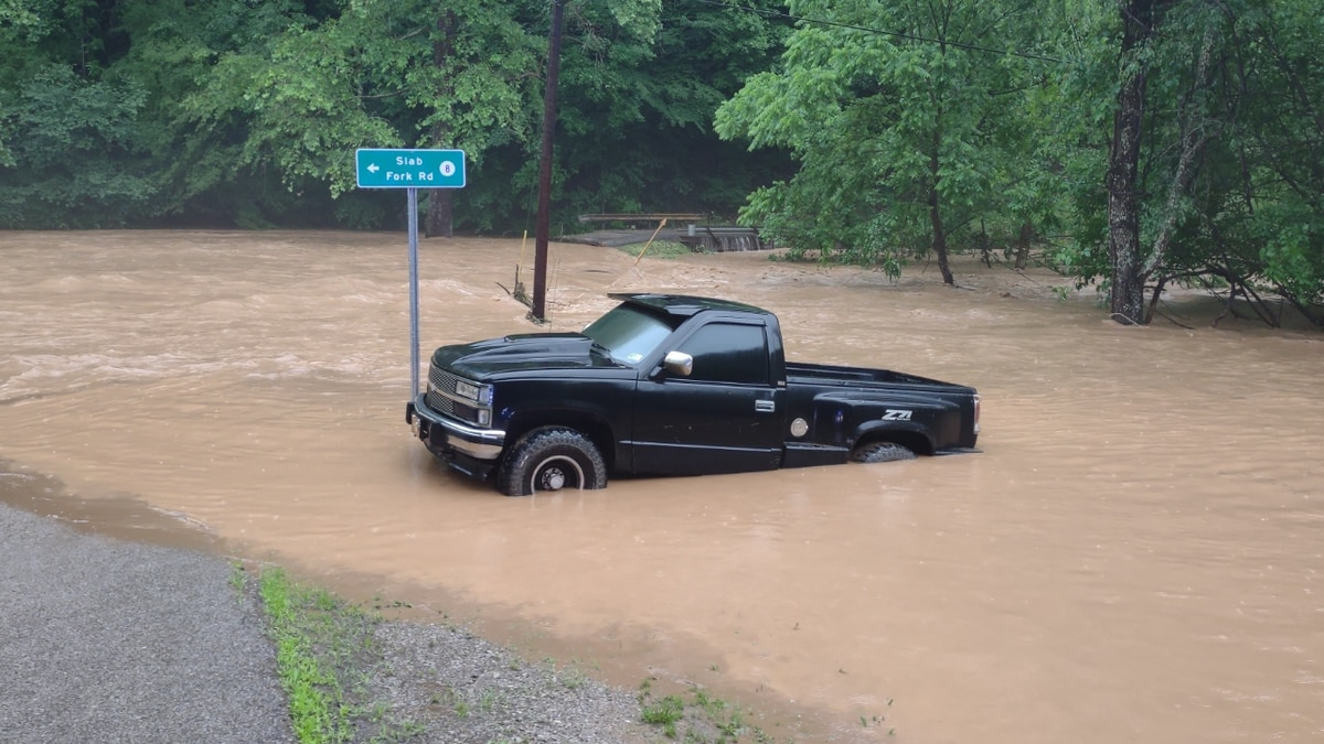 A car was surrounded with water during a flood in Calhoun County, West Virginia on Friday night.
