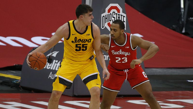 Iowa's Luka Garza, left, posts up against Ohio State's Zed Key during the first half of an NCAA...
