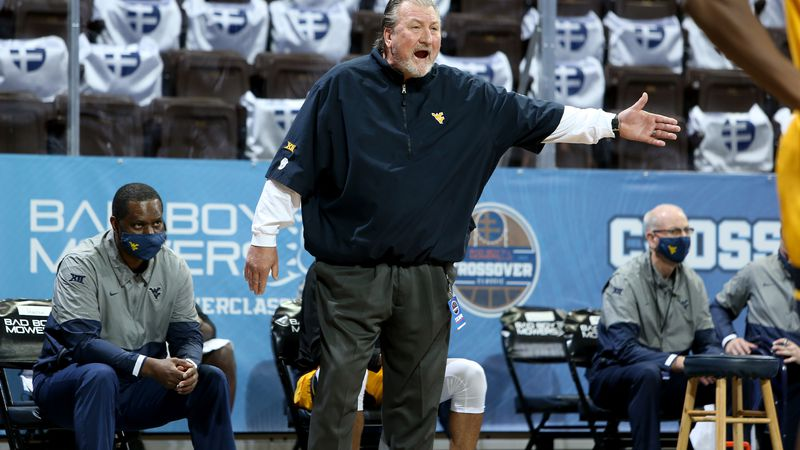 SIOUX FALLS, SD - NOVEMBER 25: Head coach Bob Huggins of the West Virginia Mountaineers shouts...