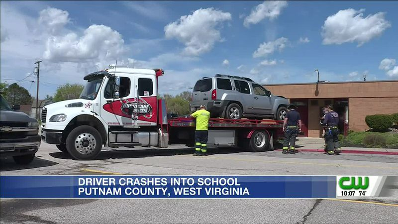 Driver crashes car into school