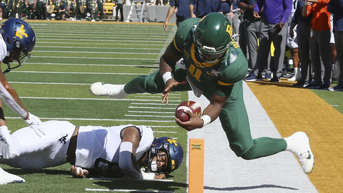 Baylor quarterback Gerry Bohanon is knocked out of bounds short of the goal line as West...