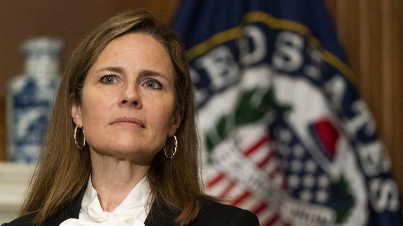 Supreme Court nominee Judge Amy Coney Barrett listens as Sen. Jerry Moran, R-Ks., not shown,...