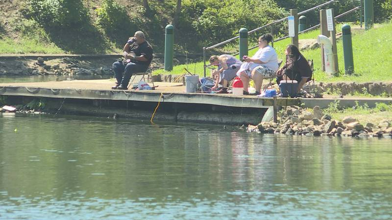 Family celebrates Labor Day by fishing in Coonskin Park.