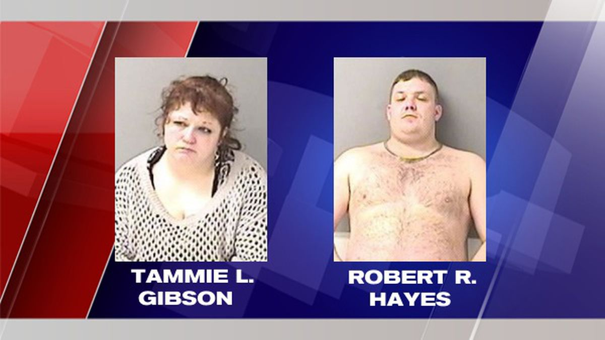 Three people charged after toddler found naked, wandering