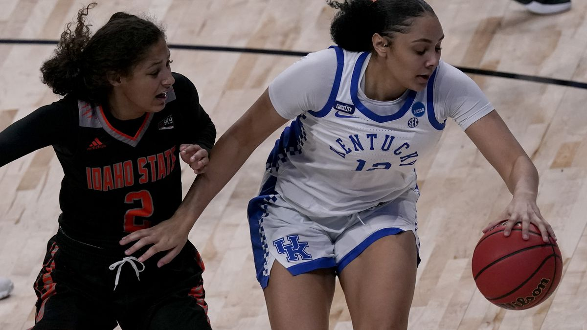 Kentucky guard Treasure Hunt (12) drives under pressure from Idaho State guard Tomekia Whitman...