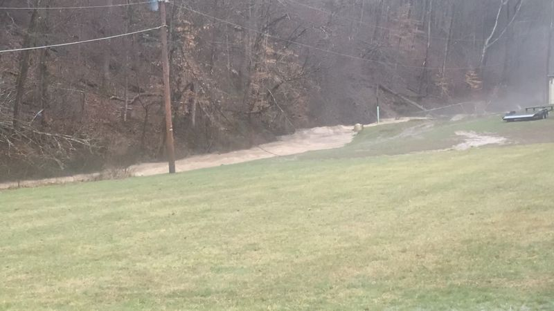 Muddy waters are making their way out of the creek along Garretts Creek Road in Wayne, W.Va.