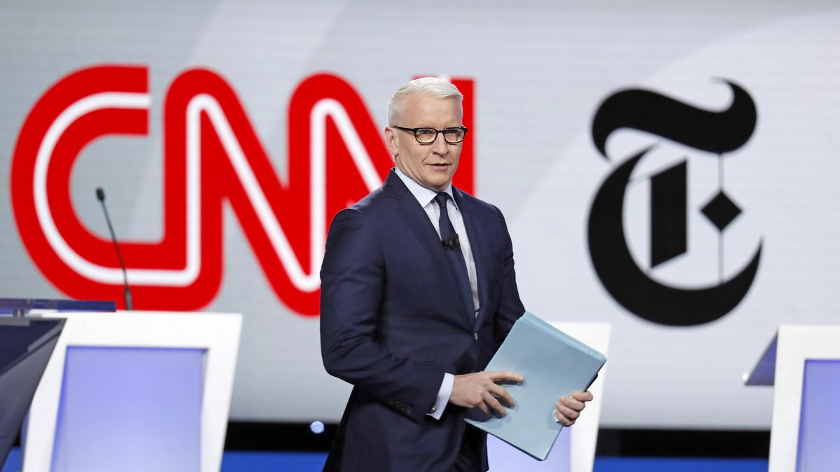 Anderson Cooper, CNN anchor, walks onstage for a Democratic presidential primary debate hosted...
