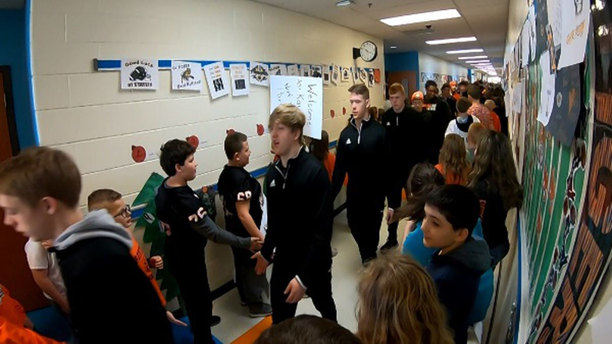 The Ironton Fighting Tigers walk through the halls of Ironton Elementary/Middle School before they head to Canton, Ohio to play for a state championship.