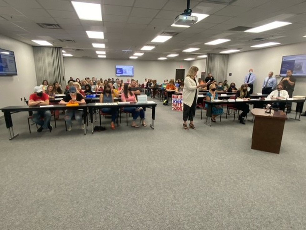 Parents both for and against a mask mandate gathered at the Putnam County Board of Education...