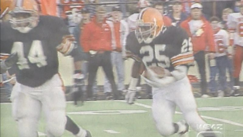 #25 Jermon Jackson carrying the football as #44 JJ King clears a path during an Ironton High...