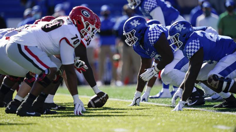 Kentucky and Georgia players line up at the line of scrimmage during the second half of an NCAA...
