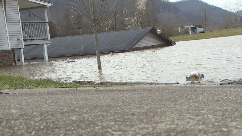 One family lost their home and both cars during flooding in Diamond, West Virginia.