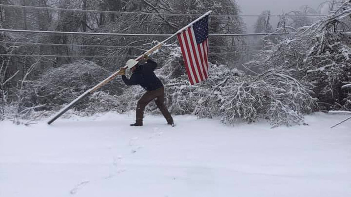 A lineworker from Ohio seen battling rough winter weather to re-hoist American flag.