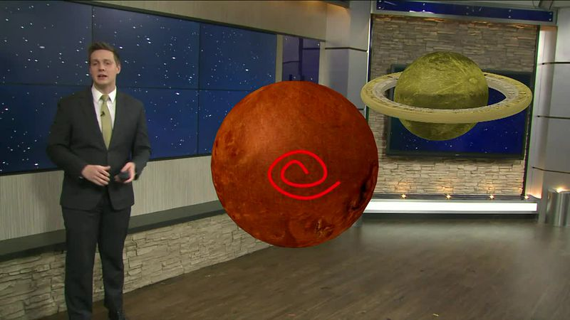 Through augmented reality graphics, meteorologist Drew Narsutis looks at the close proximity of...