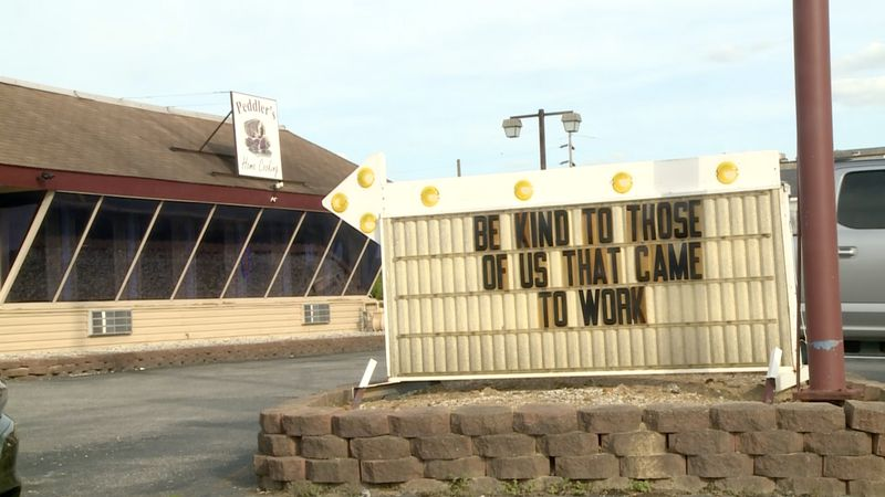"A sign outside of Peddler's Home Cooking in Ironton, Ohio reading, ""Be kind to those of us that..."