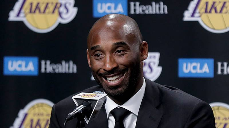 FILE - In this Dc. 18, 2017 file photo, former Los Angeles Laker Kobe Bryant talks during a...