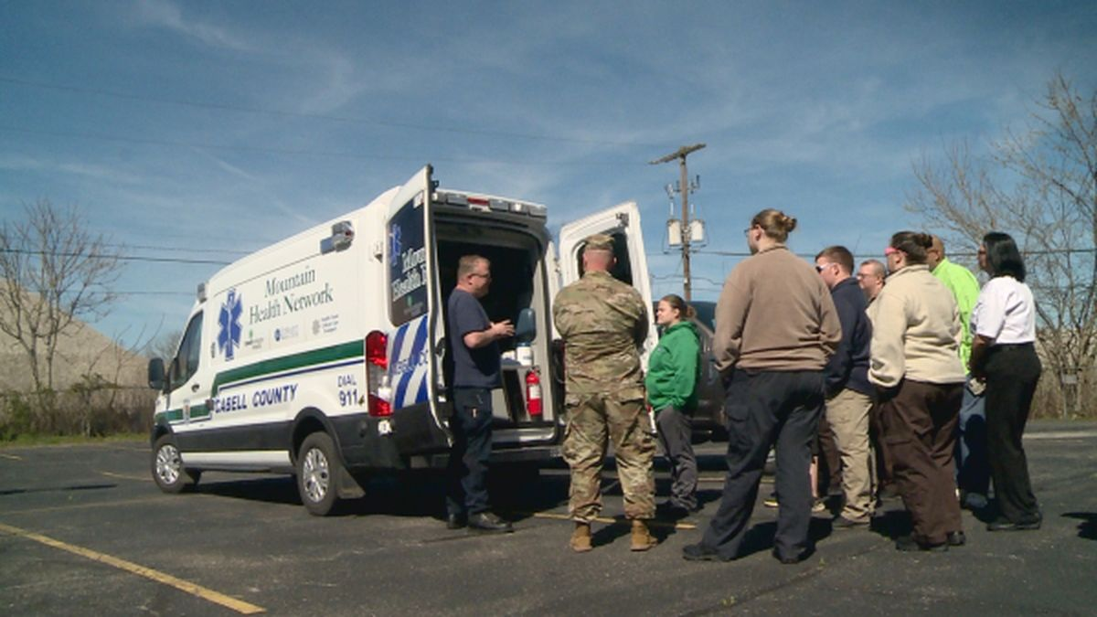 Cabell Co. EMS volunteers prepare an ambulance for transport of potential COVID-19 patients.