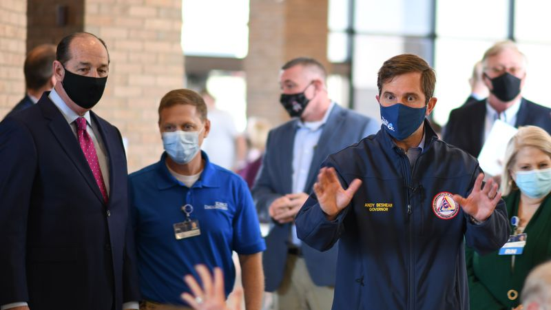 Kentucky Gov. Andy Beshear tours the KDMC vaccination clinic in Russell.