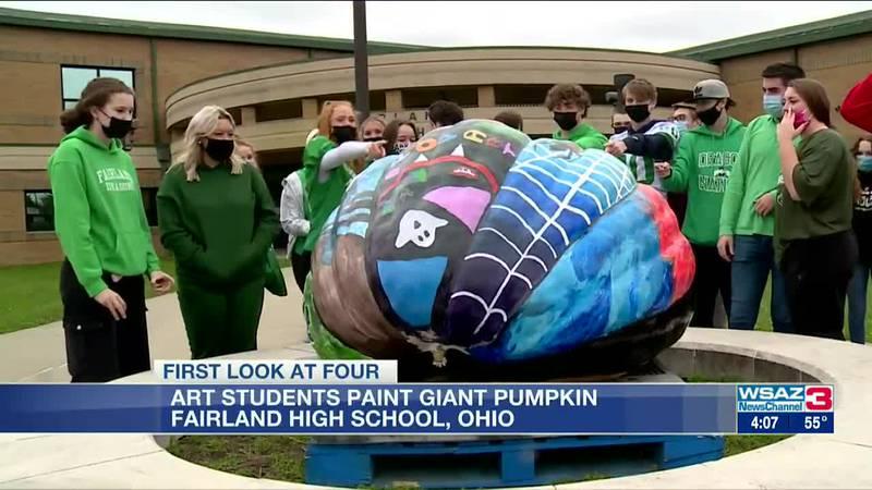 Art students paint giant pumpkin